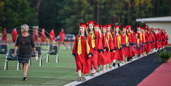 Rusk High School seniors take their seats lead by high school counselor Theresa Gates during their graduation ceremony on Friday, June 5.