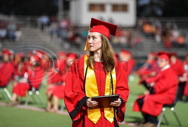Rusk High School Valedictorian Alyssa Hardy receives her diploma at the school's in-person graduation ceremony on Friday, June 5. Hardy's message to her class was one of strength to face the unknown.