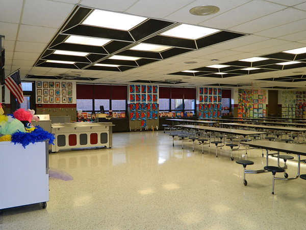 SDES cafeteria lined with a year's worth of student art at the Fine Arts Spring Fling.
