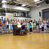 SDES fifth and sixth grade choirs performing at the Fine Arts Spring Fling.