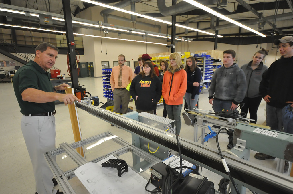 ". Abacus Automation Vice-President Richard ""Dixie\"" Zens Jr. shows a machine, his company designed, to students from Katy Schonbeck\'s Geometry class at Mount Anthony Union High School. The field trip is a part of Learning Beyond the Classroom effort where students visit a workplace for a tour and demonstration. Wednesday, October 14, 2015. Gillian Jones � Bennington Banner"