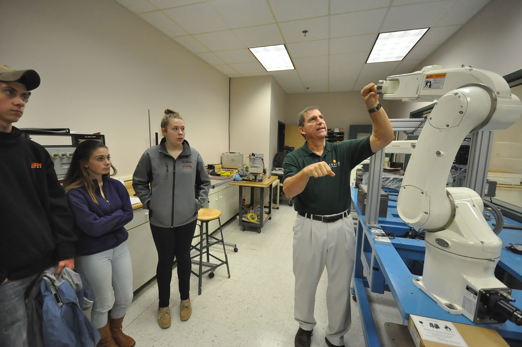 ". Abacus Automation Vice-President Richard ""Dixie\"" Zens Jr. shows a robot arm to students from Katy Schonbeck\'s Geometry class at Mount Anthony Union High School. The field trip is a part of Learning Beyond the Classroom effort where students visit a workplace for a tour and demonstration. Wednesday, October 14, 2015. Gillian Jones � Bennington Banner"