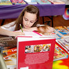Holly Pelczynski - Bennington Banner Gabrilla Holden writes a list of books she has picked out while at a school book sale on Thursday morning. The book sale, held at  The School of Sacred Heart St. Francis de Sales will run though saturday and is being held from 8am - 7pm