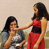 "Nataly Martinez, right,   gets a kiss from her mother, Brenda Ruiz, before  graduating from the fifth-grade.<br /> The last day of school at Sanchez Elementary in Lafayette was highlighted with a ""Continuation Ceremony"" for the  5th-graders.<br /> For more photos and a video of the ceremony, go to  <a href=""http://www.dailycamera.com"">http://www.dailycamera.com</a><br /> Cliff Grassmick/ May 26, 2011"