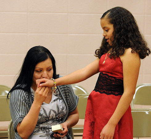 """Nataly Martinez, right,   gets a kiss from her mother, Brenda Ruiz, before  graduating from the fifth-grade.<br /> The last day of school at Sanchez Elementary in Lafayette was highlighted with a """"Continuation Ceremony"""" for the  5th-graders.<br /> For more photos and a video of the ceremony, go to  <a href=""""http://www.dailycamera.com"""">http://www.dailycamera.com</a><br /> Cliff Grassmick/ May 26, 2011"""