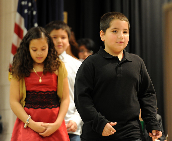 """Austin Martinez, right, walks up to get his diploma for completing the 5th-grade.<br /> The last day of school at Sanchez Elementary in Lafayette was highlighted with a """"Continuation Ceremony"""" for the  5th-graders.<br /> For more photos and a video of the ceremony, go to  <a href=""""http://www.dailycamera.com"""">http://www.dailycamera.com</a><br /> Cliff Grassmick/ May 26, 2011"""