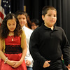 "Austin Martinez, right, walks up to get his diploma for completing the 5th-grade.<br /> The last day of school at Sanchez Elementary in Lafayette was highlighted with a ""Continuation Ceremony"" for the  5th-graders.<br /> For more photos and a video of the ceremony, go to  <a href=""http://www.dailycamera.com"">http://www.dailycamera.com</a><br /> Cliff Grassmick/ May 26, 2011"
