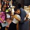 "Leidy Pineda hugs Principal, Dr Doris Candelarie, right, and teacher, Bev Sanders hugs Aiyanna Medina in the background, after  the Sanchez 5th-graders received their ""graduation diploma.""<br /> The last day of school at Sanchez Elementary in Lafayette was highlighted with a ""Continuation Ceremony"" for the  5th-graders.<br /> For more photos and a video of the ceremony, go to  <a href=""http://www.dailycamera.com"">http://www.dailycamera.com</a><br /> Cliff Grassmick/ May 26, 2011"
