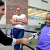 YNN's Maria Valvanis interviews Jermaine Jackson age 7 with his mother Tabitha Pando looking on. Troy's School 2 started a new school year with a new Principal, school uniforms and new hours from 7:30AM to 4:30PM.  Thursday 09/05/13 (Mike McMahon/The Record)