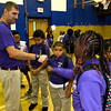Physical Education teacher Brian Benner, who is also wearing the school iuniforn, gives a fist bump to 5th grade student Kelasia Harris.Troy's School 2 started a new school year with a new Principal, school uniforms and new hours from 7:30AM to 4:30PM.  Thursday 09/05/13 (Mike McMahon/The Record)