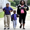 5th grade student Ayanna Allen, her brother Pre-K student Ahmad and  mother Eleana Allen walk to School 2 in Troy. Troy's School 2 started a new school year with a new Principal, school uniforms and new hours from 7:30AM to 4:30PM.  Thursday 09/05/13 (Mike McMahon/The Record)