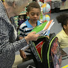 MIKE McMAHON - MMcMAHON@DIGITALFIRSTMEDIA.COM, School Grandma Jackie Nash helps Alexavier MacPherson first grader unpack his backpack on the first day of school at Watervliet Elementary , Wedesday September 3, 2014.
