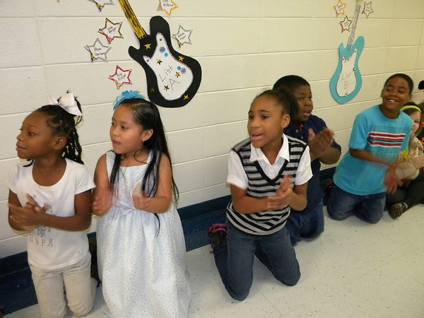 Cherokee students, from left, Dashea Vaughn, Yasmin Munguia, Denise Bowler, Sean Carter and Joshua Davis cheer for schoolmates participating in the Fluency Run, held Friday in the school halls.