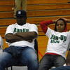"Former New York Jets linebacker Kenyatta Wright and eighth-grader Joseph Birmingham, right, wear ""Man-Up"" T-shirts given out Tuesday during the Boys Bash assembly at Alice Robertson Junior High. The T-Shirts were designed to challenge eighth-grade boys to make the right decisions."