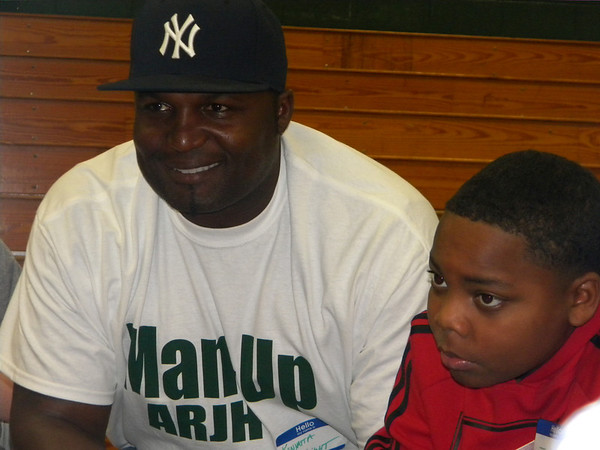 Former New York Jets linebacker Kenyatta Wright and eighth-grader Joseph Birmingham listen during a small group discussion Tuesday at Alice Robertson Junior High. AR sponsored a motivational assembly, Boys Bash, for eighth-graders.