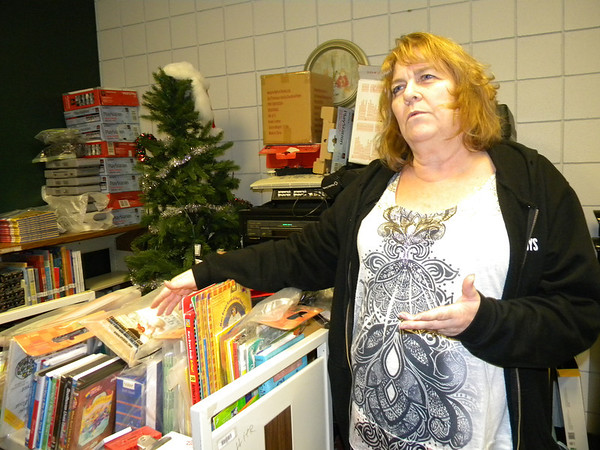Whittier Elementary Media Specialist Rogena McClain discusses some of the updated shelving and materials the library needs. A $47,000 grant from the Jimmie Johnson Foundation will help the school update its library.