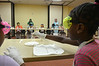 Youngsters handle test samples as they learn about acids and bases during the Science in the Summer program at the Abington Free Library.   Thursday,  July 3, 2014.   Photo by Geoff Patton