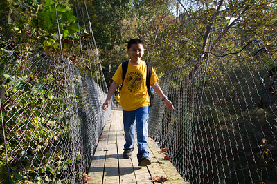 Brandon walking across the bridge