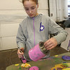 Project Explore at Shawsheen Tech, where 7th graders try out different shops. Hailey Welch, 12, of Billerica, tries out airbrushing in Auto Body. (SUN/Julia Malakie)