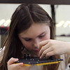 Project Explore at Shawsheen Tech, where 7th graders try out different shops. Hera Lewis, 12, of Billerica, works on a robot in Electronics. (SUN/Julia Malakie)