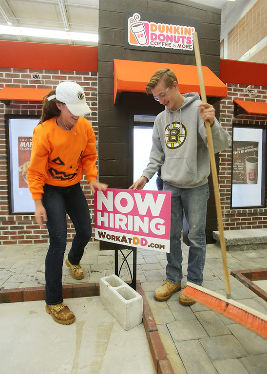 . Shawsheen Tech masonry students are building a Dunkin\' Donuts for the school\'s annual open house. Juniors Rachel Conway and Derek Leffler, both 16 and from Tewksbury. (SUN/Julia Malakie)