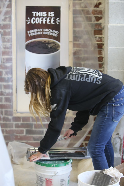 . Shawsheen Tech masonry students are building a Dunkin\' Donuts for the school\'s annual open house. (SUN/Julia Malakie)
