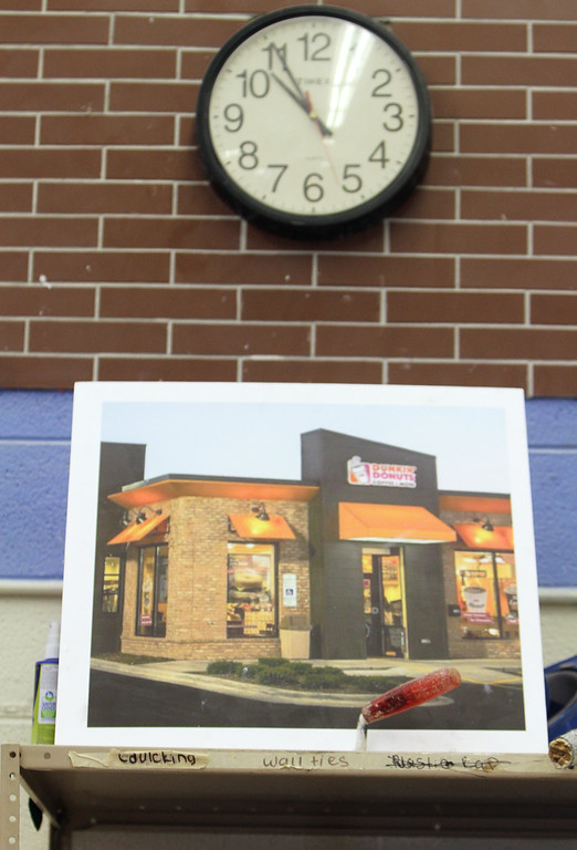 . Shawsheen Tech masonry students are building a Dunkin\' Donuts for the school\'s annual open house, based on this picture. (SUN/Julia Malakie)