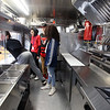 Shawsheen Tech culinary students in the school's recently acquired food truck. From left, senior Anthony DiCesare of Tewksbury, senior Cameron Sousa of Wilmington, sophomore Jonn Durfee of nd sophomore Emma Caswell of Tewksbury. (SUN/Julia Malakie)
