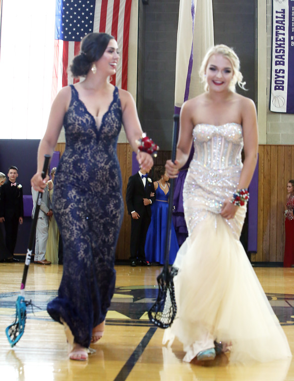 . Pre-prom procession at Shawsheen Tech. Megan Brown, left, and Shelby Delosh, both of Billerica, carry their lacrosse sticks. (SUN/Julia Malakie)
