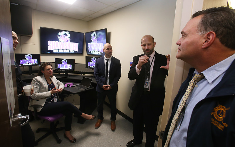 Shawsheen Tech superintendent Tim Broadrick and principal Jessica Cook show local officials the school's recently created Crisis Command Center. From left, deputy police chief Roy Frost (behind door), principal Jessica Cook, State Rep. Marc Lombardo, who helped obtain $50,000 in state funding to support the project, and police chief Dan Rosa. (SUN/Julia Malakie)