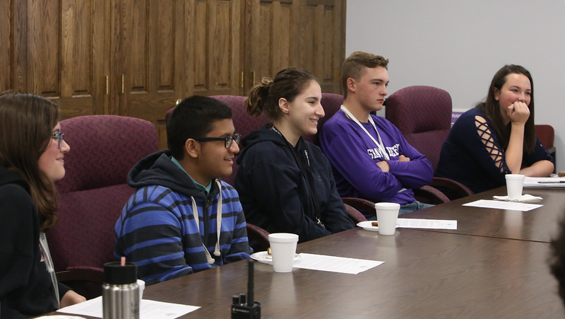 Members of the superintendent's cabinet, from left, freshman Isabel Fiasconaro of Billerica, sophomore Mohammadali Khalifa of Billerica, sophomore Jorielle Arlock of Tewksbury, junior Andre Comeau of Burlington, and junior Grace Clark of Bedford, in meeting with Shawsheen Tech superintendent Tim Broadrick, principal Jessica Cook and local officials to discuss the school's security measures and recently created Crisis Command Center. (SUN/Julia Malakie)