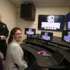 Shawsheen Tech principal Jessica Cook, with deputy police chief Roy Frost, showing him and other local officials the school's recently created Crisis Command Center. (SUN/Julia Malakie)