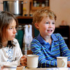 "Shepherd Valley Waldorf School006.JPG Second grade student Laura Siebenmorgan, left, and preschool student Samuel Snyder enjoy their oatmeal and tea on Wednesday, April 4, at the Shepherd Valley Waldorf School in Niwot. For a video about the Shepherd Valley Waldorf School cookbook program go to  <a href=""http://www.dailycamera.com"">http://www.dailycamera.com</a><br /> Jeremy Papasso/ Camera"