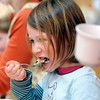 "Shepherd Valley Waldorf School005.JPG Preschool student Sidonia Alexander, center, takes a bite of oatmeal during snack time on Wednesday, April 4, at the Shepherd Valley Waldorf School in Niwot. For a video about the Shepherd Valley Waldorf School cookbook program go to  <a href=""http://www.dailycamera.com"">http://www.dailycamera.com</a><br /> Jeremy Papasso/ Camera"
