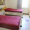 A bedroom in one of the Shriver Jop Corp center 's female dorms. SENTINEL & ENTERPRISE/JOHN LOVE