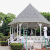 Students from the Shriver Job Corp on Devens work on fixing up the gazebo at Carter Park in Leominster on Monday.  SENTINEL & ENTERPRISE/JOHN LOVE