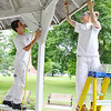 Devens Shriver Job Corp students Andrew Dasiova, 19, from RI and Edna Rosado, 22, of Fitchburg work on fixing up the gazebo at Carter Park in Leominster on Monday.  SENTINEL & ENTERPRISE/JOHN LOVE