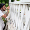 Devens Shriver Job Corp student Jeremy Jalbert, 23, from Lowell works on fixing up the gazebo at Carter Park in Leominster on Monday with his fellow classmates.  SENTINEL & ENTERPRISE/JOHN LOVE