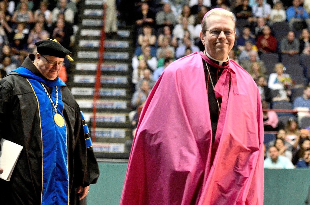 . L-R Siena President Fr. Kevin Mullen andEdward B. Scha fenberger, D.D., Bishop of Albany at Siena College commencement at the Times Union Center in Albany, Sunday  May 18,  2014 (Mike McMahon - The Record)