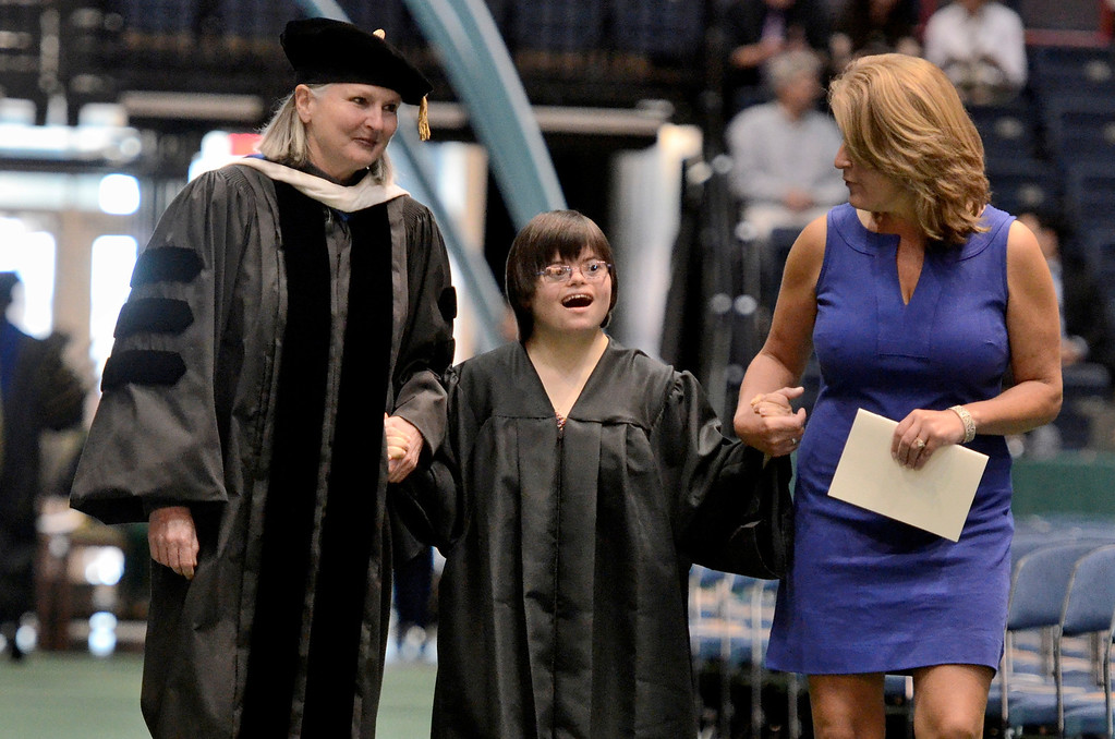 . Dr. Meg Woolbrigh,t Emily Jahn who is graduation fron the Transition Program  and  Heather Hanrahan Special Education teacher at Shaker High School, Siena College commencement at the Times Union Center in Albany, Sunday  May 18,  2014 (Mike McMahon - The Record)