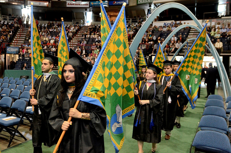 Siena College students receiving awards for excellence in major fields carry flags in commencement procession at the Times Union Center in Albany, Sunday  May 18,  2014 (Mike McMahon - The Record)