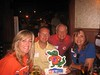 Carol and Gary Bruehler '64 and friends at a Houston Gator Club party.