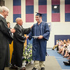 Thomas Brennan receives his diploma during the commencement ceremony at the Sizer School on Thursday evening. SENTINEL & ENTERPRISE / Ashley Green
