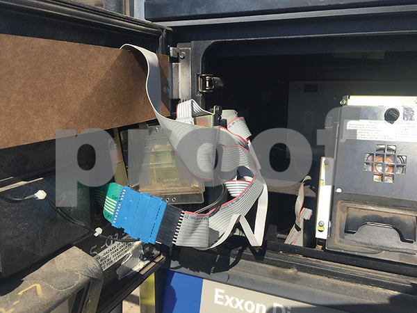 Components of a credit card skimming device are shown inside of a gas pump at the Exxon gas station at 2615 E. Commerce St. The smaller strip on the right is the device that trasnsmitts the credit card information to the criminals who installed the device. Detectives with the Northeast Texas Financial Crimes Task Force located the skimmer Thursday during a random check of the gas station. (LouAnna Campbell/Tyler Morning Telegraph)