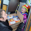 Leominster's Sky View Middle School students dropped off food to Ginny's Food Pantry on Thursday afternoon after school. Seventh graders Ruby Roberge, 12, and Meryl Warpula, 13, take some of the food they collected off the bus that dropped them off right in front of Ginny's on Mechanic Street in Leominster. SENTINEL & ENTERPRISE/ JOHN LOVE