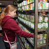 Sky View Middle School students dropped off food to Ginny's Food Pantry on Thursday afternoon after school. Stacking the shelves with the food they brought is sixth grader Monique Baxley, 12. SENTINEL & ENTERPRISE/ JOHN LOVE