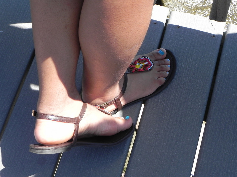 I don't have a name for this photo, but i thought it looked cute with the boardwalk and a bit of water. Her toenails really do pop!