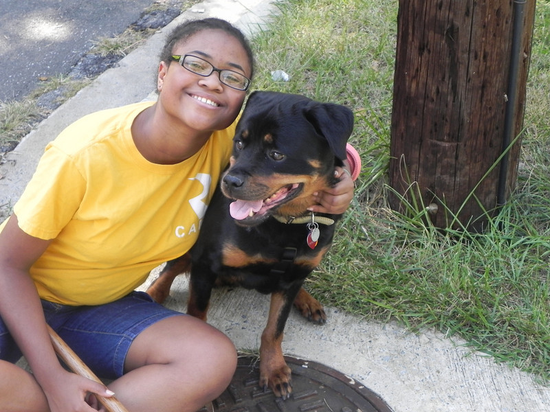 """This is a shot of Bryanna and our dog Roxanne (Roxie for short.) Roxie is what my family calls a """"toy Rottweiler."""" She may be small, but trust me, she's really strong!"""