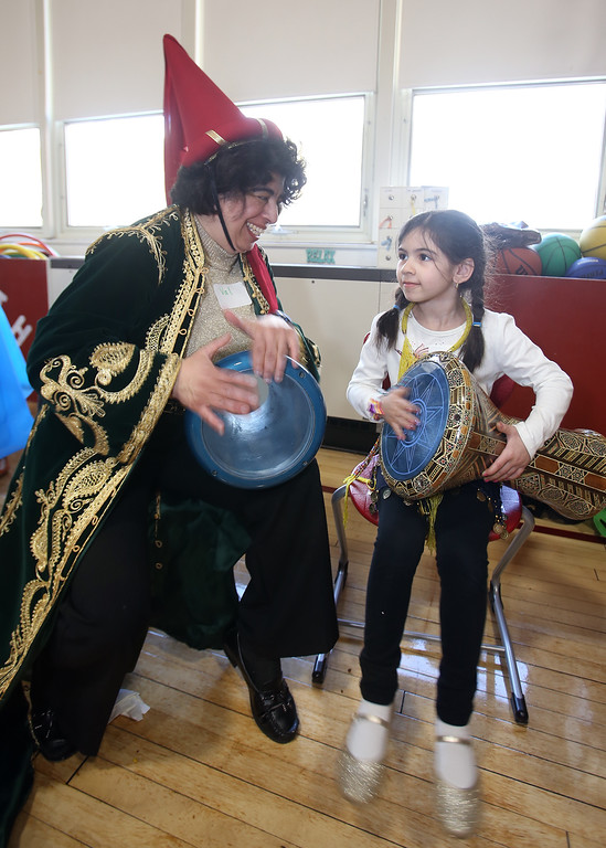 . South Row School International Festival in Chelmsford. Val Sarkis of Townsend and her niece Eva Papadopoulos, 6, a 1st grader at South Row, play dirbake, a Lebanese drum. (SUN/Julia Malakie)