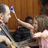 South Row School International Festival in Chelmsford. Claire Alex, right, a kindergarten student at South Row, with her father John Alex playing bass guitar. (SUN/Julia Malakie)